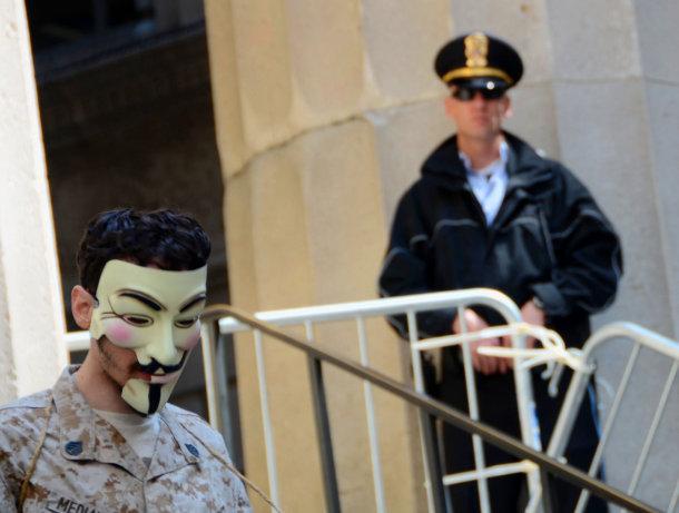 anonymous-sad-cop_610x461